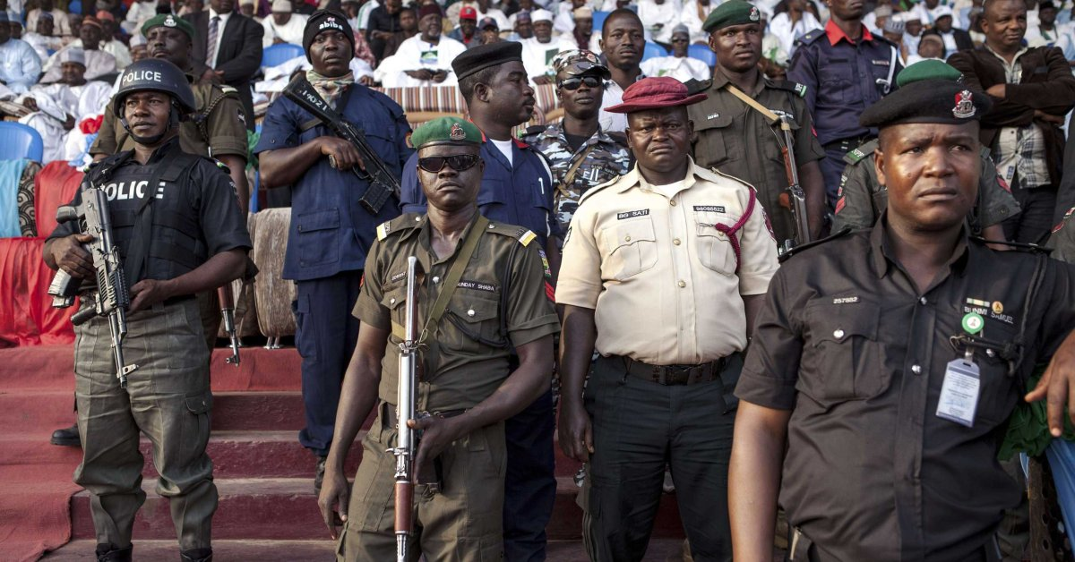 Policemen and soldiers guard during a rally of the main Nigerian opposition All Progressive Congress (APC) party in Kaduna on January 19, 2015. The head of Nigeria's electoral body on January 23 maintained that elections set for February 14 will still take place, despite concerns about whether voter cards will be distributed in time. AFP PHOTO / FLORIAN PLAUCHEURFLORIAN PLAUCHEUR/AFP/Getty Images